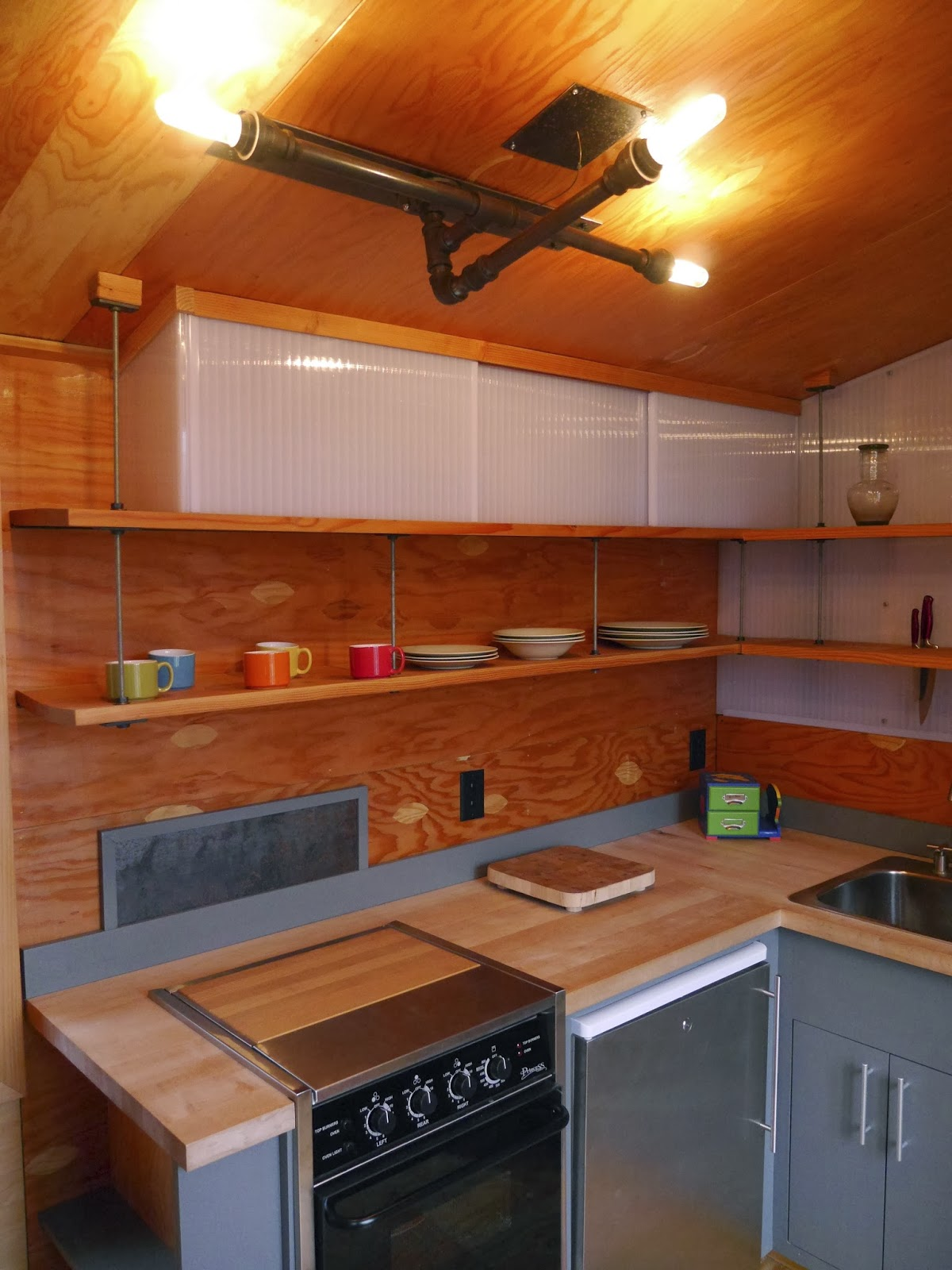 """Relaxshacks.com: A GREAT Tiny House Modern Kitchen in """"The ..."""