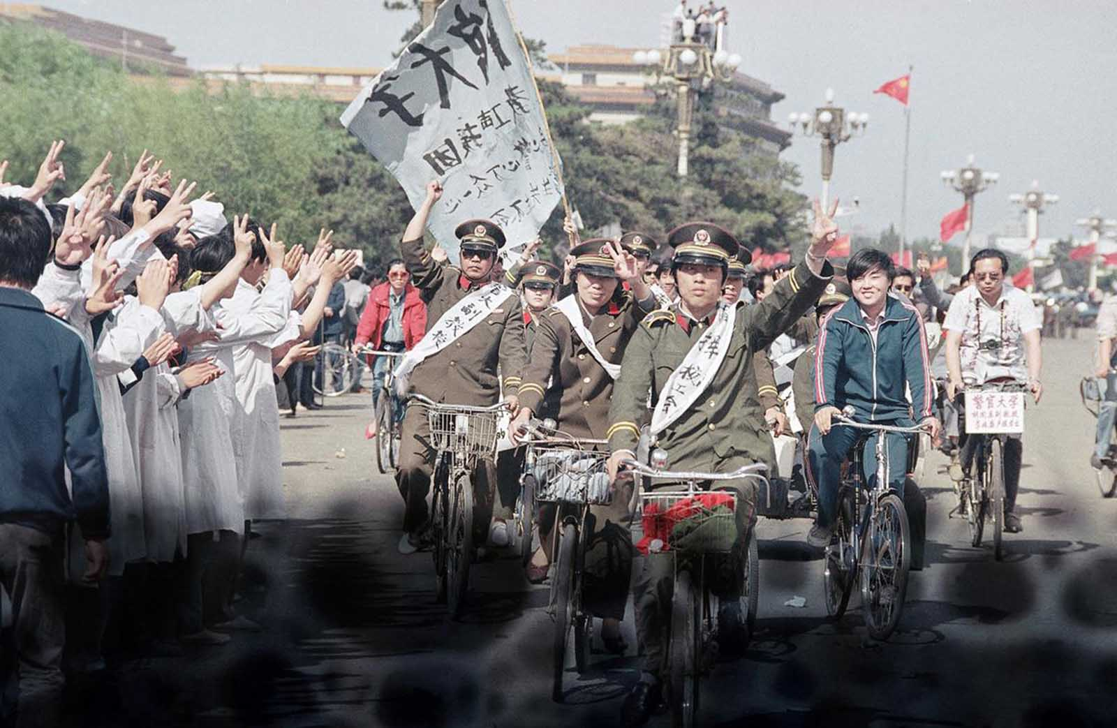 Beijing police parade through Tiananmen Square carrying banners in support of striking University students, on May 19, 1989. The students were in the sixth day of their hunger strike for political reform.
