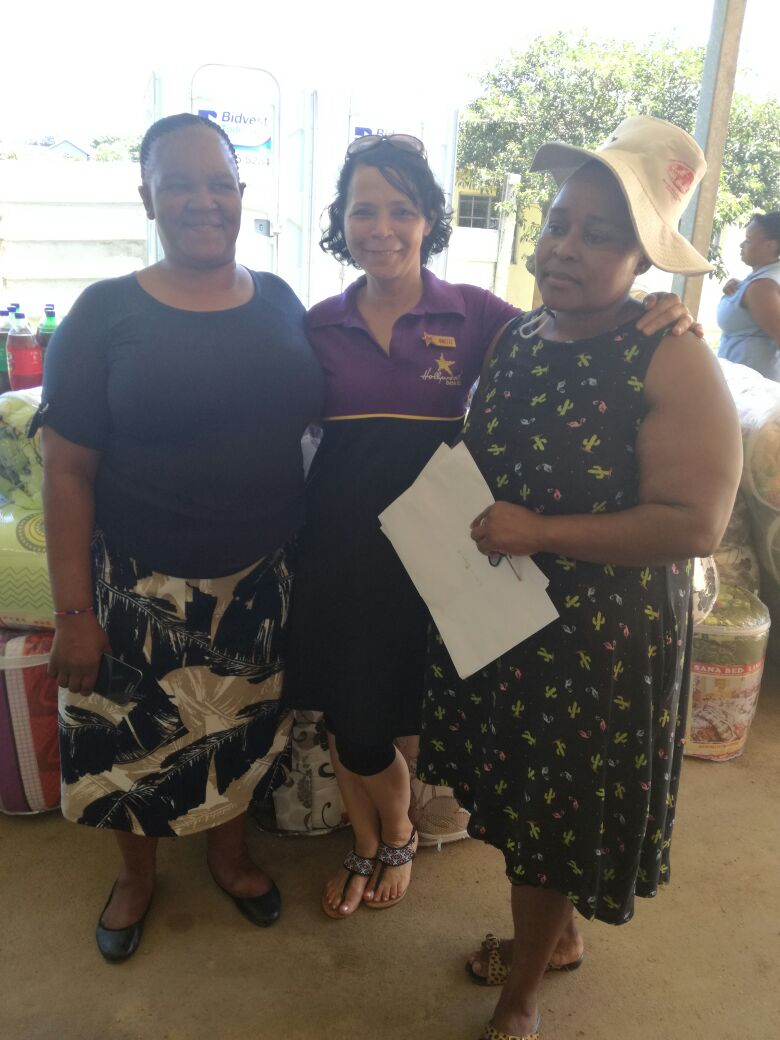 Staff members at Ubuntu Crisis and Family Care Centre are happy to receive a donation from Hollywoodbets