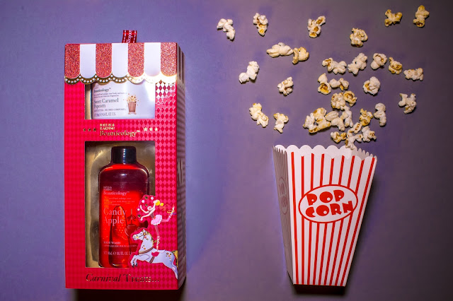 A carnical themed gift set and a popcorn box spilling confetti