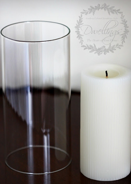Glass sleeve and fluted vanilla candle in the guest room.