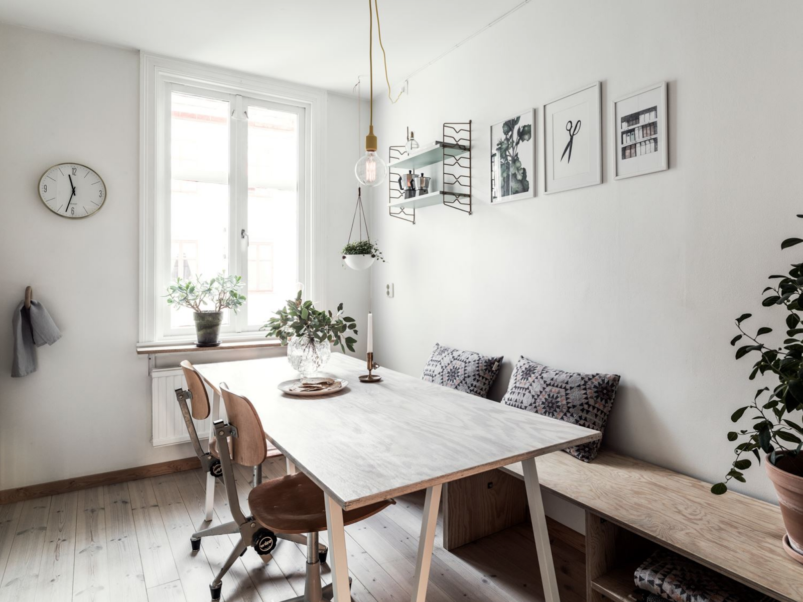 dining table and vintage chairs in the nordic design kitchen