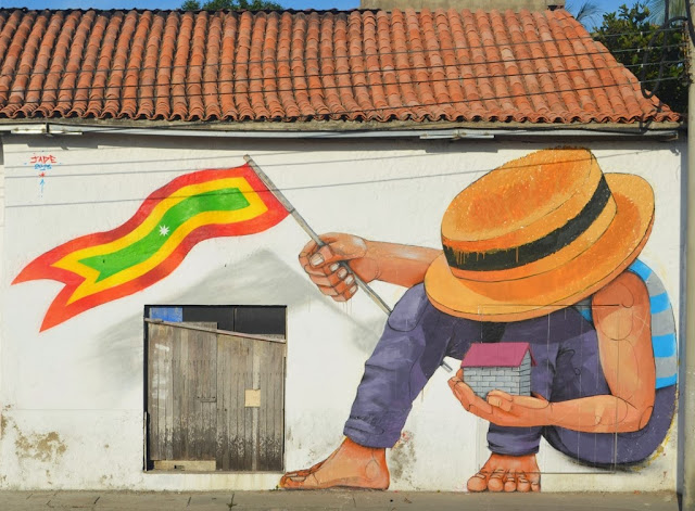 Street Art by Peruvian Artist JADE on the streets of Cartagena in Colombia. 2