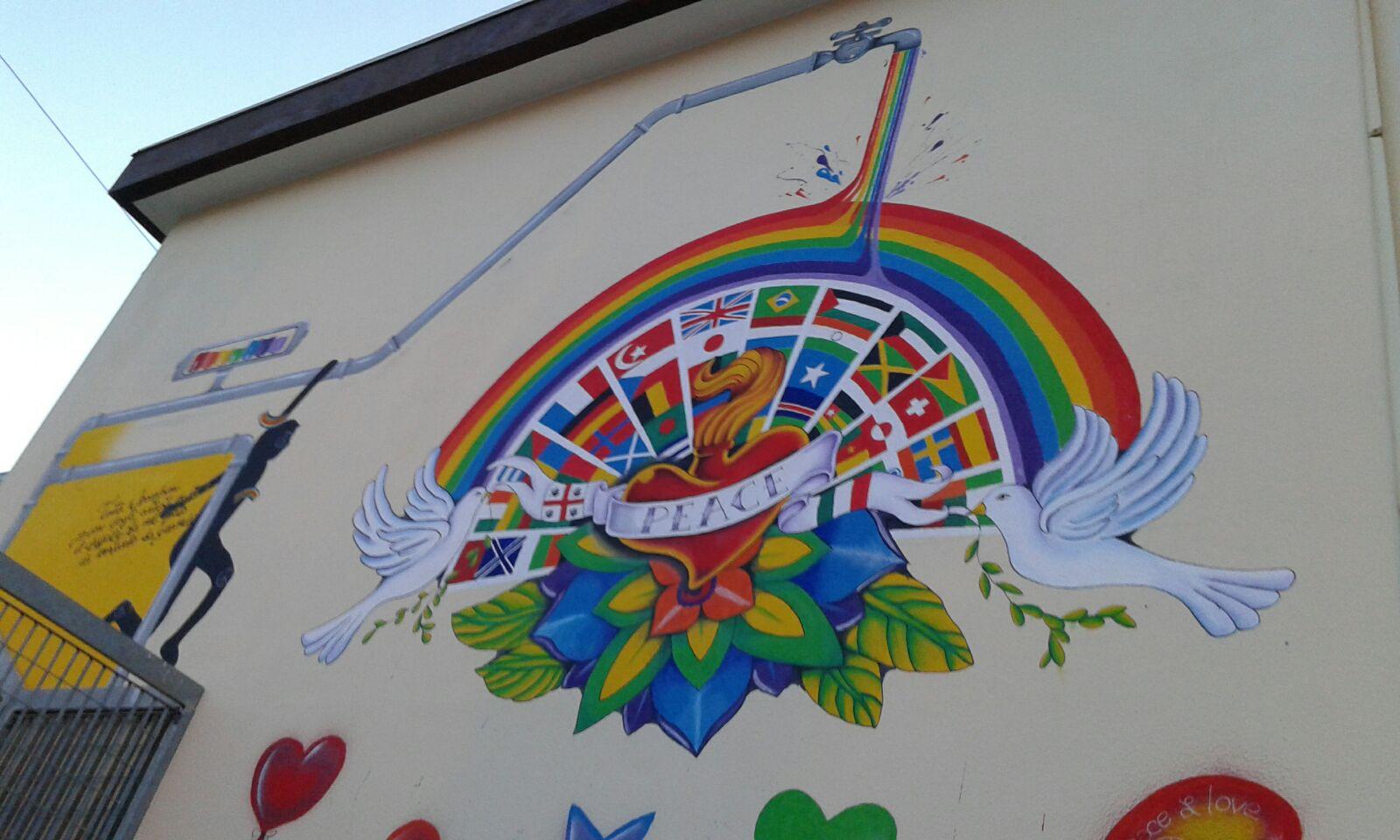 Eccezionale ISTITUTO COMPRENSIVO ELEONORA D'ARBOREA: Murale nel giardino della  UT67