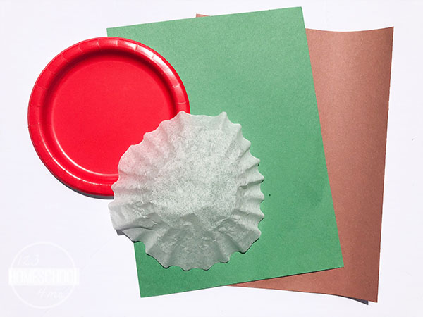 red paper plate, coffee filter, green and brown construction paper, scissors and glue or tape
