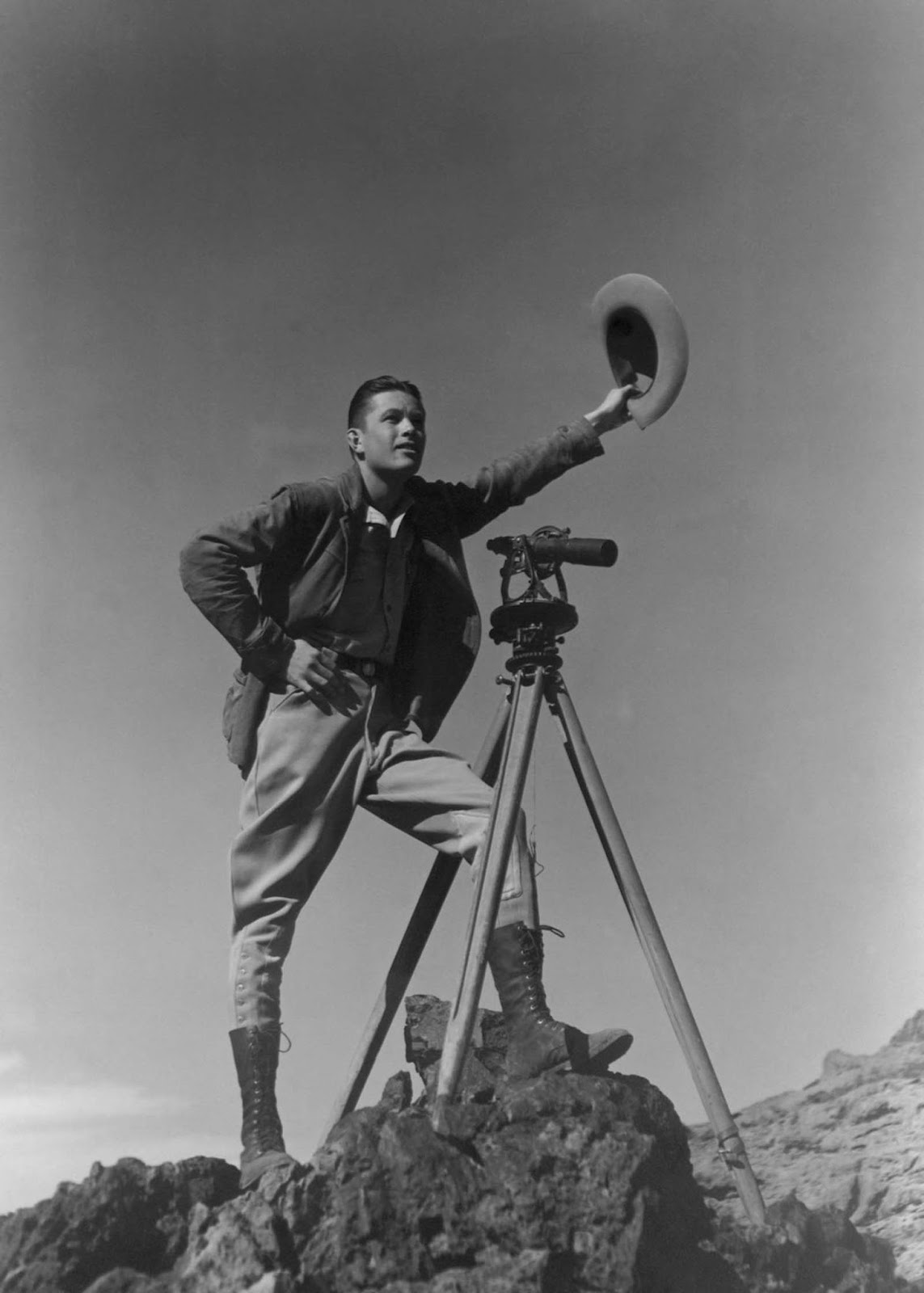 A surveyor signals to colleagues during the construction of the dam. 1932.