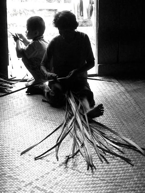 Photo of basket weaving Iban tribe