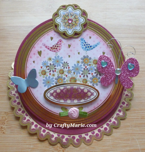 Circle round easel card example with Hunkydory card toppers designs birds flowers gold and dark pink colors butterfly embellishments
