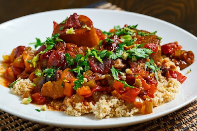 Veal shanks braised in a sweet and savoury tomato sauce with a Moroccan spice blend Ossobuco Tagine (Moroccan Style Ossobuco) Recipe