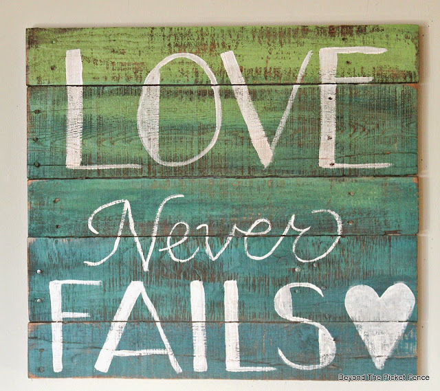 love never fails pallet sign with ombre paint finish