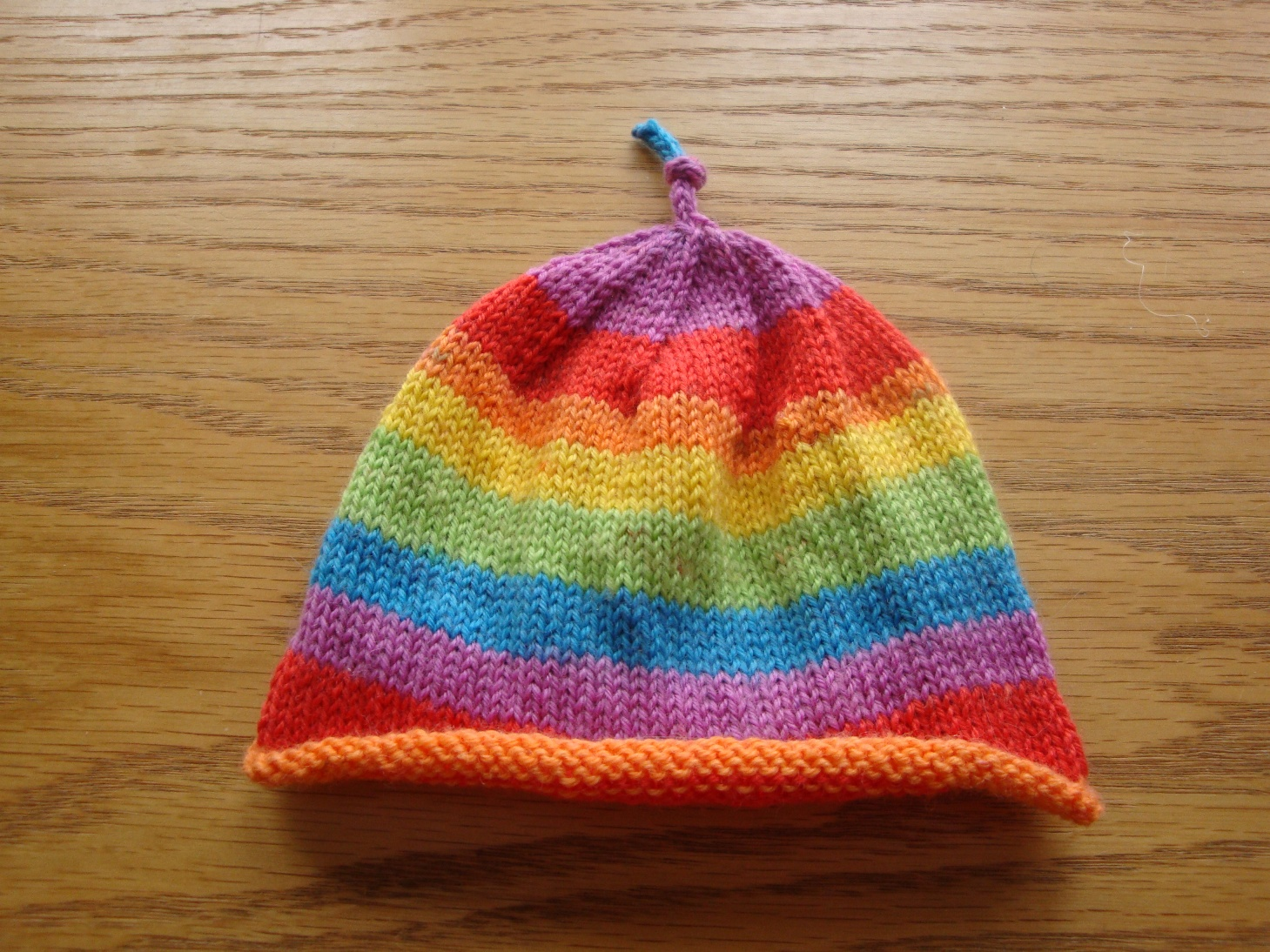 Pattern  Easy Peasy Newborn Sock Hat by Keri McKiernan. Yarn  KnitPicks  Felici in Rainbow c2e989047cc