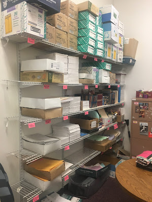 storage shelves in an office before a reorganization using the konmari method