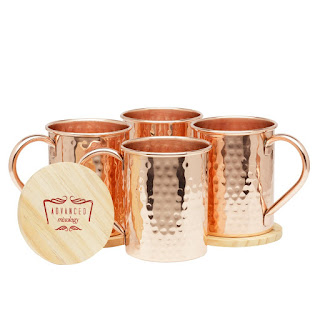 I am in love with Moscow Mule Mugs - they are handcrafted, 100% copper and they are just beautiful and shiny.  Moscow Mule Mugs were created for the drink of the same name but they work great for any mixed drink and they definitely lend an air of style to any get-together or party.  I love all the styles and shapes they have and they really look antique and it makes me think of the old days when all they had were copper mugs before plastic was invented.  These awesome mugs also keep your drinks colder longer and they have great handles that are welded so there is not problem with handles coming off.    The best part is that they won't tarnish, they are easy to clean and this set just happens to come with 4 mugs and 4 pure wood coasters that are smooth and perfectly round.  No rough edges on any of it!  This one would make an awesome gift set and would go great as an addition to any drink mix set :)  $53.99 on Amazon, pick a set up today for someone and start their collection!