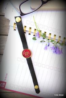 LoveLea's black leather bracelet with red vintage button