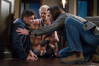 "Jensen Ackles as Dean Winchester, Dee Wallace, Jared Padalecki as Sam Winchester in Supernatural 11x11 ""Into the Mystic"""