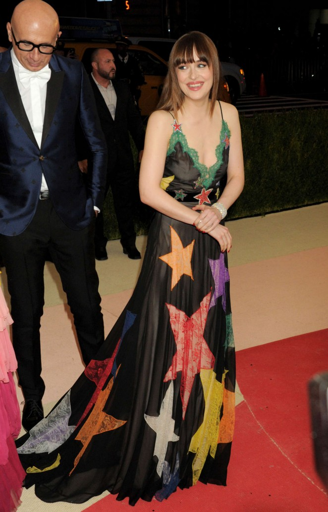 Dakota Johnson in a low cut gown at the Met Gala 2016
