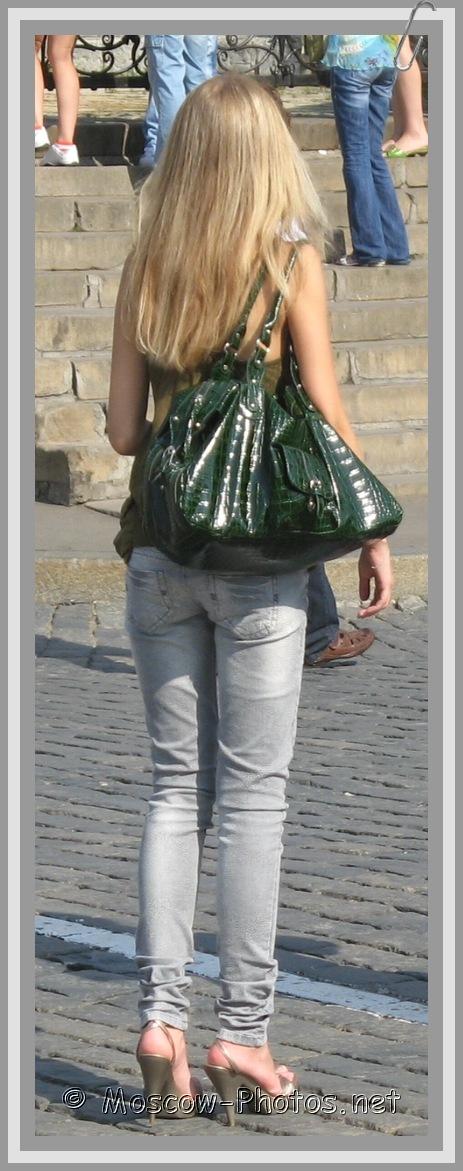 Slim Blonde Girl In Vintage Jeans