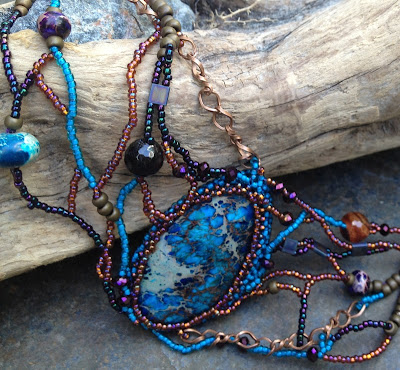 closeup of Wrack and Ruin, freeform beaded necklace & earrings by Karen Williams