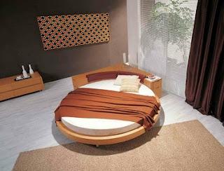 dormitorio con cama redonda