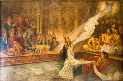 The disrobing of Draupadi in the Kaurava court, while Krishna miraculously provides an endless suppy of cloth to protect her modesty.
