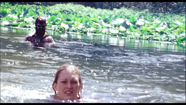 One of the alien dead stalks a woman in a river
