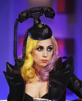 Lady Gaga with a phone on her head