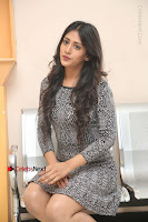 Actress Chandini Chowdary Pos in Short Dress at Howrah Bridge Movie Press Meet  0137.JPG