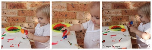 Baby painting with Lego