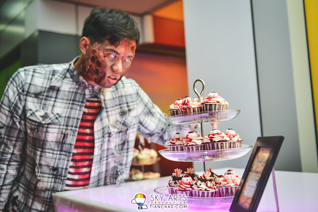 Zombie eying for the cupcakes with eyes on it