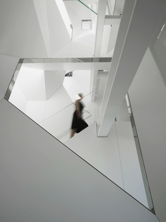White penthouse walls and glass railings