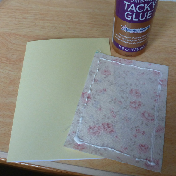 Glue the backing fabric to the card front