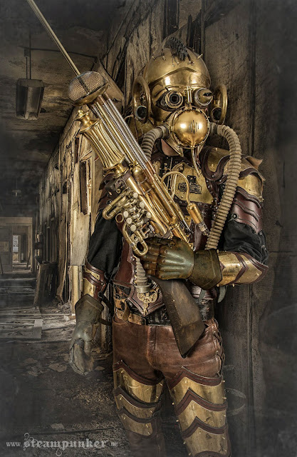 Man dressed in steampunk costume made of leather and brass with a large gun made from trumpet parts