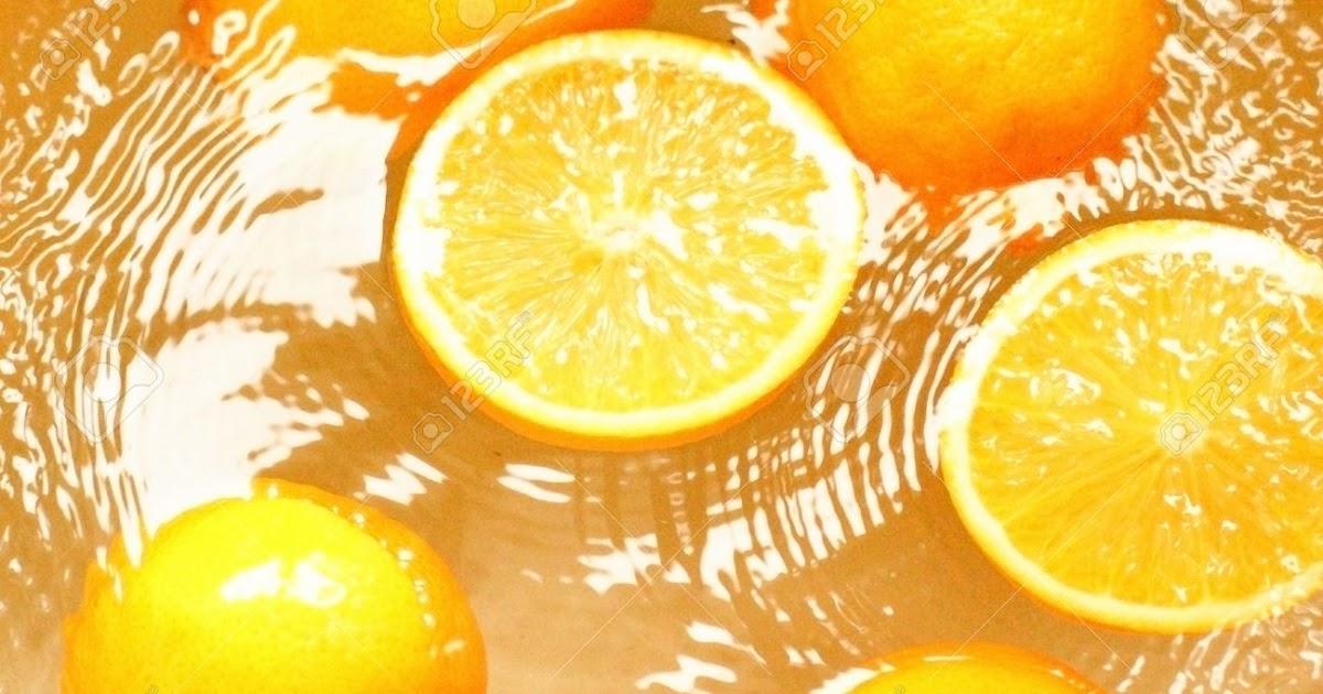 Baño De Florecimiento Sencillo: -naranjas-frescas-de-frutas-ba-o-en-jugo-agua–Foto-de-archivojpg