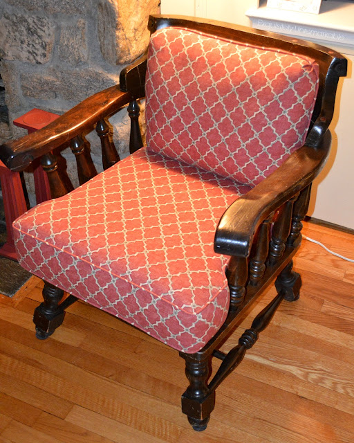 Wooden Captains Chair with red fabric on cushions
