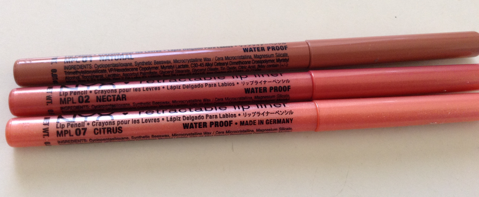 nyx retractable lip liner in natural nectar citrus swatches review