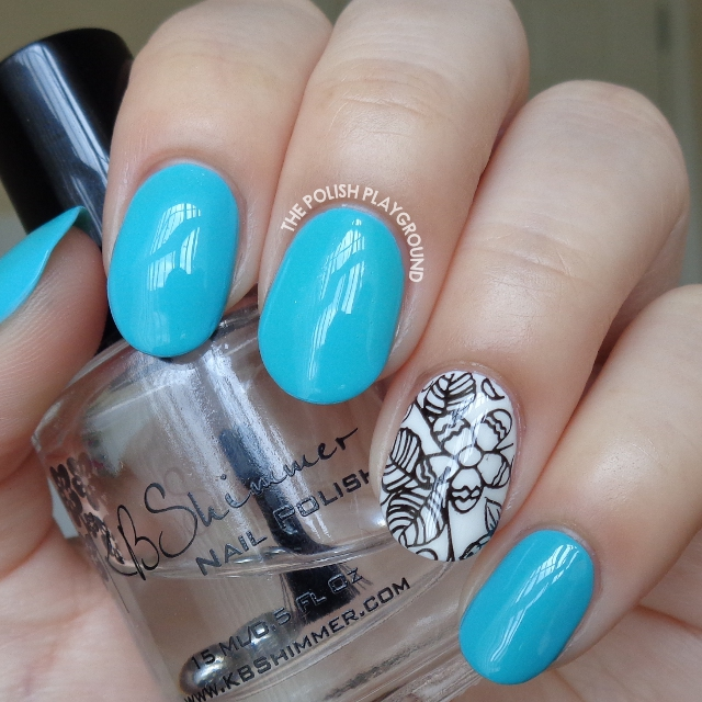 Turquoise Blue with Black and White Floral Accent Nail Art