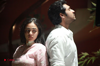 Nithya Menen super cute and beautiful romancing Krish in telugu movie Ghatana