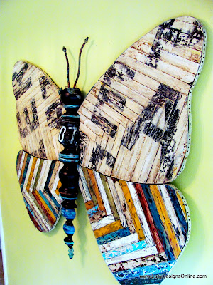 giant recycled wooden butterfly art with reclaimed wood and sign