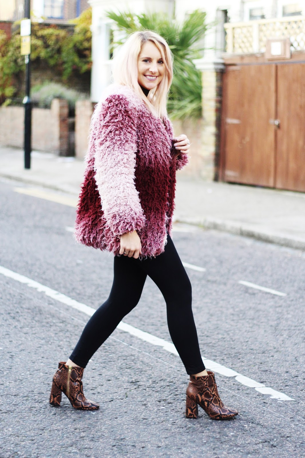 pink fluffy coat street style