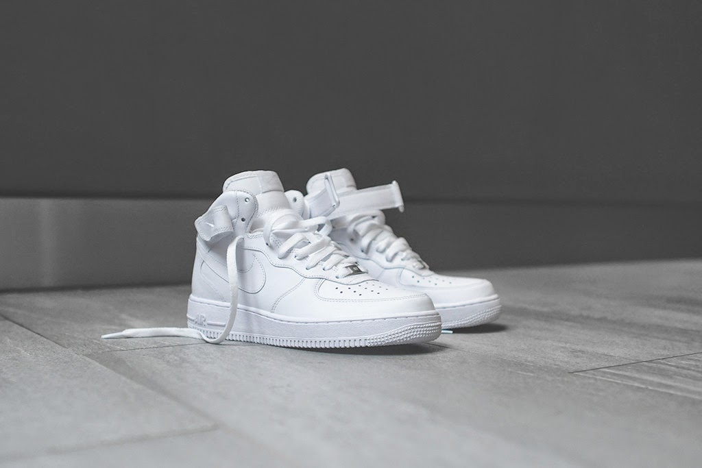 The white monochromatic Air Force 1 Mid is one of the most iconic Nike  sneakers of all time. An upper made entirely of white smooth synthetic  leather on top ... 9be9f5f58