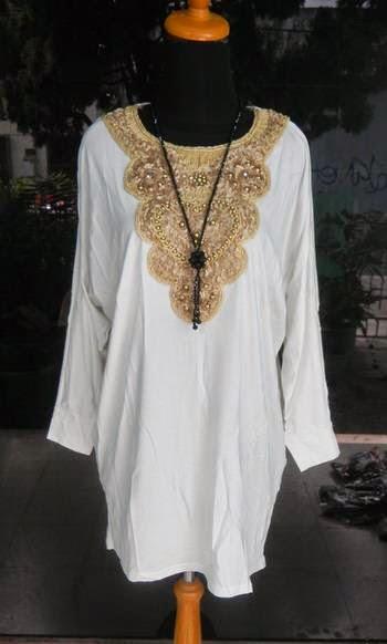 http://berita-21.blogspot.com/2014/04/model-busana-muslim-modis-terbaru-2014.html
