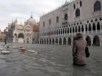 Scientific research indicates sea levels worldwide have been rising at a rate of 0.14 inches (3.5 millimeters) per year since the early 1990s. The trend, linked to global warming, puts thousands of coastal cities, like Venice, Italy, (seen here during a historic flood in 2008), and even whole islands at risk of being claimed by the ocean. (Photograph Credit: Andrea Pattero/AFP/Getty Images) Click to Enlarge.