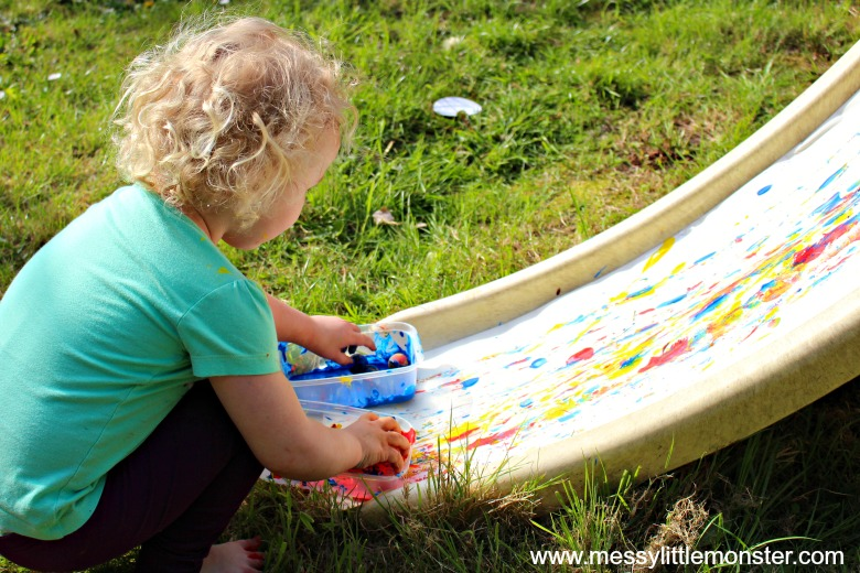 outdoor art project for kids - painting on a slide with bouncy balls