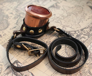 Steampunk monocle with copper metal eyecup, leather strap and red color lens for cosplay and costumes