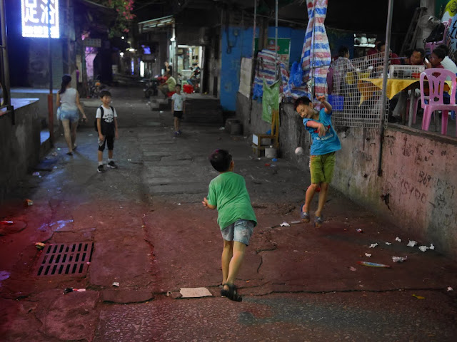 boy jumps out of the way of a paper ball thrown by another boy in Zhuhai, China