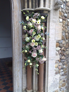 Flowers at church door for wedding