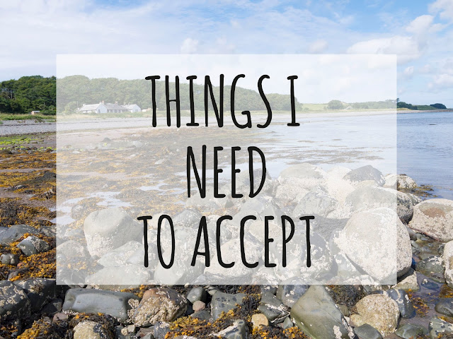 a picture of a rocky beach and blue sky overlaid with black text reading 'things I need to accept'