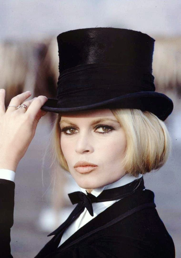 1c6afd11b31b7c Brigitte Bardot wearing a structured hat while making motion picture