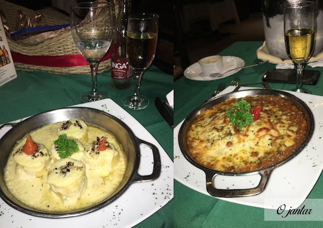 jantar no restaurante italiano de lasanha bolonhesa e rondele ao molho branco