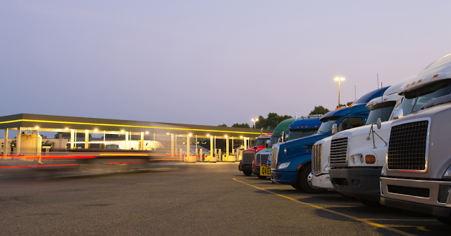 Truckers at gas station using ExpressIFTA for IFTA fuel tax reporting